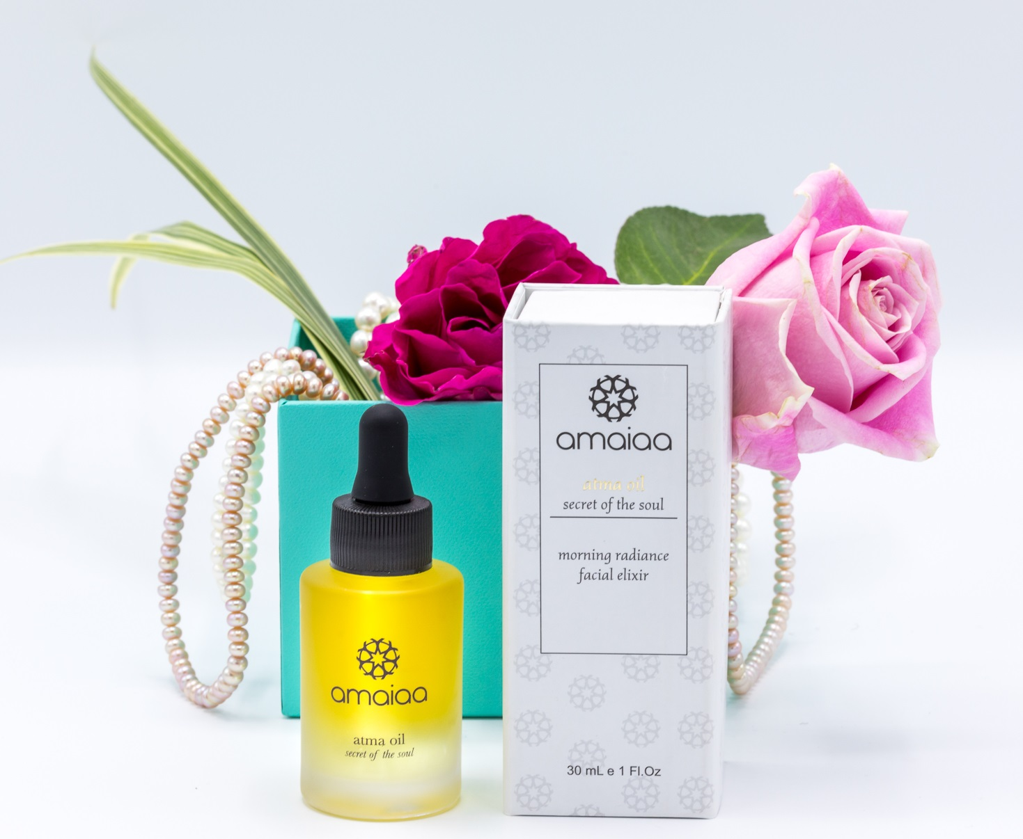 atma facial oil for night time with box and roses